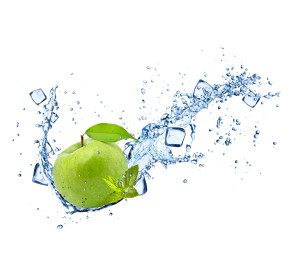 Green apple with water splashes on white